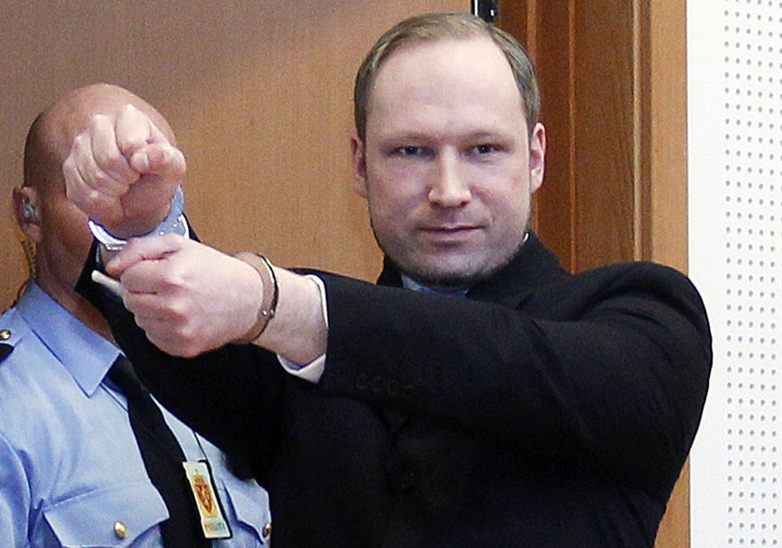**FILE** Anders Behring Breivik, a right-wing extremist who confessed to a bombing and mass shooting that killed 77 people on July 22, 2011, gestures as he arrives for a detention hearing at a court in Oslo, Norway, on Feb. 6, 2012. (Associated Press/Scanpix Norway)