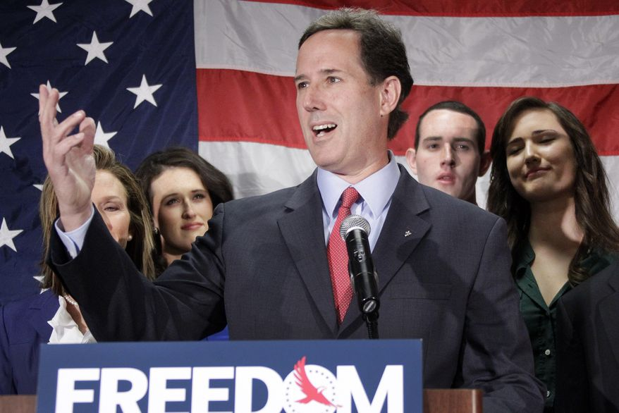 Former Pennsylvania Sen. Rick Santorum, surrounded by his family, announces on Tuesday, April 10, 2012, in Gettysburg, Pa., that he is suspending his GOP presidential campaign. (AP Photo/Gene J. Puskar)