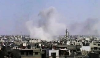 In this image made from amateur video released by the Syrian Media Council and accessed Tuesday, April 10, 2012, smoke rises following purported shelling in Homs, Syria. The Associated Press cannot independently verify the content, date, location or authenticity of this material. (AP Photo/Syrian Media Council via AP video)