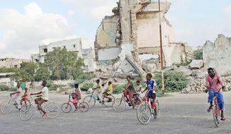 """In the year since African Union and Somali troops pushed Islamist militants out of the capital of Mogadishu, Somali children are free to ride their bicycles in the streets of the seaside capital, and people can enjoy the beaches, go out to dinner and dance at weddings. """"The city is returning to normal now,"""" said banker Liban Abdi Igal, who was recently living in Maryland. """"I have returned here with optimism after seeing progress and revival."""" (Associated Press)"""