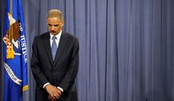 Attorney General Eric Holder is seen at a news conference at the Justice Department in Washington, Wednesday, April 11, 2012. The Justice Department and several states have sued Apple Inc. and major book publishers, alleging a conspiracy to raise the price of electronic books that Attorney General Eric Holder says cost consumers millions of dollars. (AP Photo/Cliff Owen)