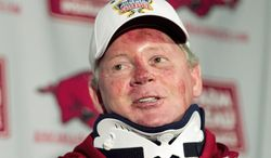 Bobby Petrino's downfall at Arkansas started with a motorcycle crash and ended with revelations that he paid his mistress $20,000 before hiring her to the football staff. (Associated Press)
