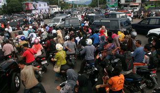 Motorists get stuck in traffic as they evacuate to higher ground after a quake was felt in Banda Aceh in the Aceh province on Sumatra island. (Associated Press)