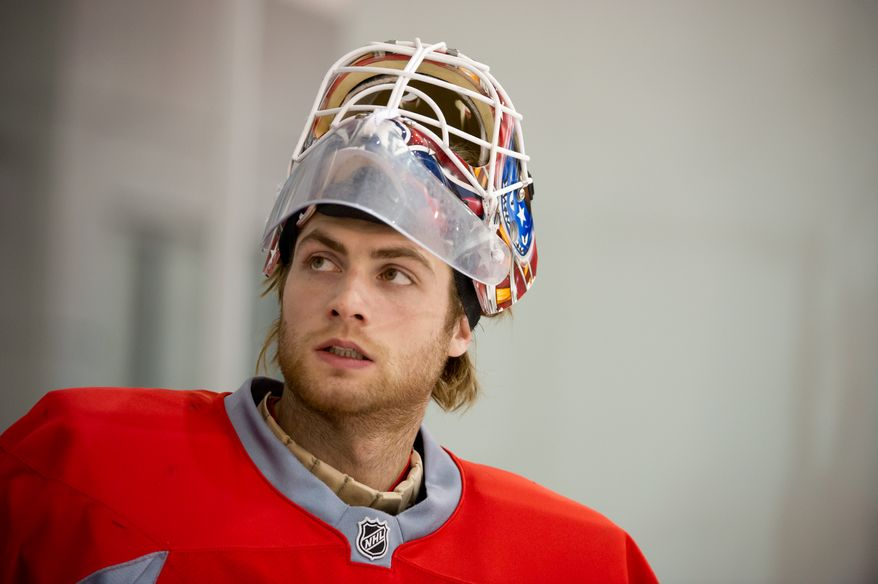 Washington Capitals goalie Braden Holtby (70) heads out to the ice for a morning practice at Kettler Capitals Iceplex, Arlington, Va., Tuesday, April 10, 2012. (Andrew Harnik/The Washington Times)