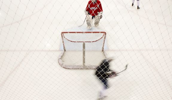 Washington Capitals goalie Braden Holtby (70), top center, takes a break during morning practice at Kettler Capitals Iceplex, Arlington, Va., Tuesday, April 10, 2012. (Andrew Harnik/The Washington Times)