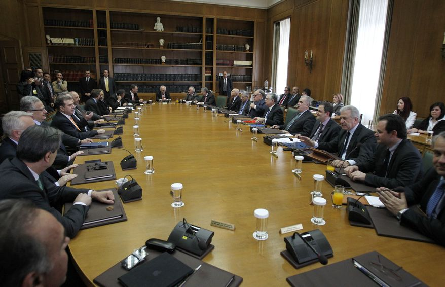 Members of the Greek government attend a Cabinet meeting at the Parliament in Athens on Wednesday, April 11, 2012. Prime Minister Lucas Papademos formally will ask President Karolos Papoulias for a general election on May 6. (AP Photo/Thanassis Stavrakis)