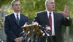 Hal Uhrig (right) and Craig Sonner, former attorneys for George Zimmerman, speak to reporters during a news conference on Tuesday, April 10, 2012, in Sanford, Fla., to announce that both lawyers had quit as Mr. Zimmerman's legal representatives. (AP Photo/Phelan M. Ebenhack)