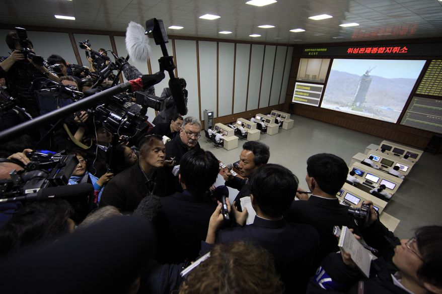 Paek Chang-ho (center), head of the General Launch Command Center, briefs journalists inside the center in Pyongyang, North Korea, on Wednesday, April 11, 2012, on the Kwangmyongsong-3 satellite that is expected to be launched in the coming days. (AP Photo/Ng Han Guan)