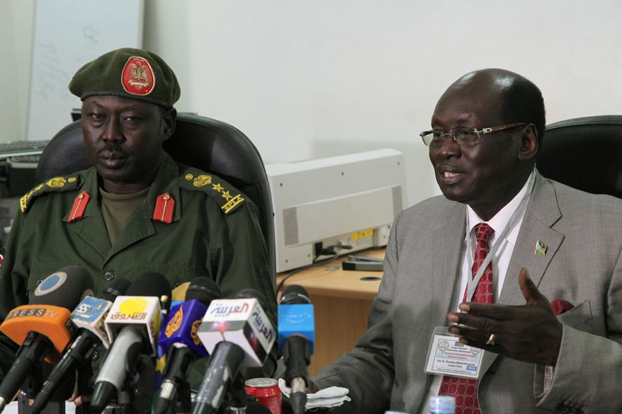 **FILE** Barnaba Benjamin Marial (right), the South Sudanese minister of information, and military spokesman Philip Aguer brief the media on March 27, 2012, in Juba, South Sudan, about recent fighting between Sudanese and South Sudanese forces along the north-south border. (Associated Press)
