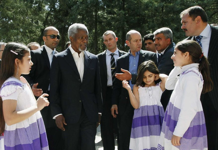U.N.-Arab League envoy Kofi Annan, third from left, is welcomed by Syrian refugee children upon his arrival at Yayladagi refugee camp in Hatay province, Turkey, Tuesday, April 10, 2012. (AP Photo/Umit Bektas, Pool)