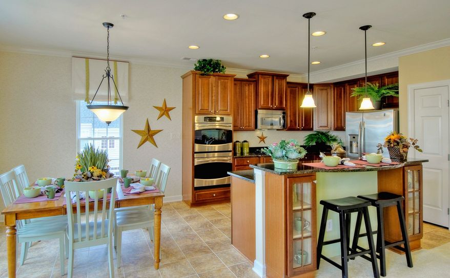 Both models at Linton at Bellenger Crossing feature 42-inch oak cabinets and a pantry in the kitchen.