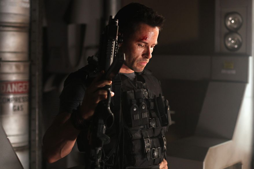 """Guy Pearce is so glib and entertaining in the space-prison sci-fi movie """"Lockout"""" that he almost makes up for the production's numerous deficiencies. (Film District via Associated Press)"""
