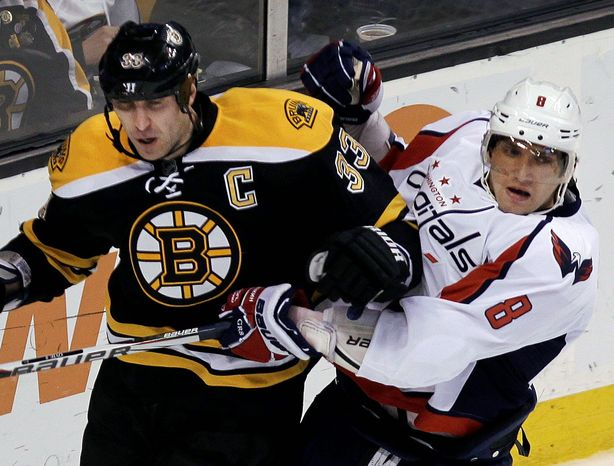 Bruins defenseman Zdeno Chara (left) and Capitals left wing Alex Ovechkin figure to battle for every inch of space during their Eastern Conference quarterfinal series. (Associated Press)