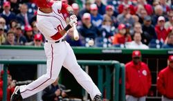 Washington Nationals shortstop Ian Desmond (20) batts as the Washington Nationals defeat the Cincinnati Reds in extra innings, 3-2, for their home opener in Major League Baseball at Nationals Park, Washington, D.C., Thursday, April 12, 2012. (Andrew Harnik/The Washington Times)