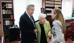 Joan Lovering Boos, who was a Cherry Blossom princess for the first postwar festival, in 1948, meets 2011 Cherry Blossom queen Allison Speaker of Shepherdstown, W.Va. With them is Mrs. Boos' husband, Fred. (Daniel Jackson/The Washington Times)