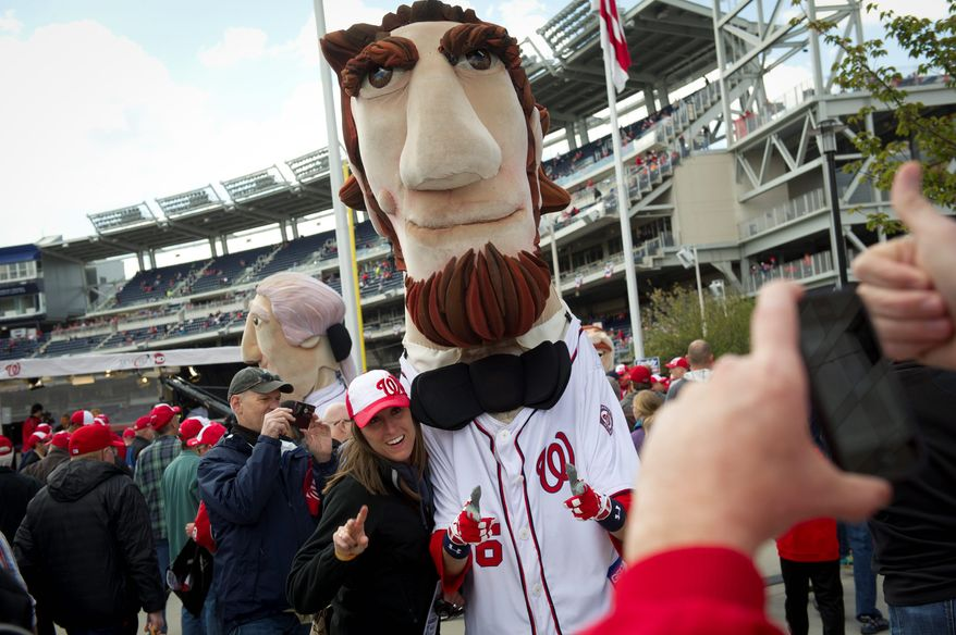 It's an election year, so Nicole Desonia, of Centreville, Va., cast her vote for Abe, of The Racing Presidents, before the Nationals' home opener Thursday. (Rod Lamkey Jr./The Washington Times)