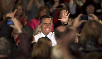 Republican presidential candidate and former Massachusetts Gov. Mitt Romney waves before addressing an audience April 11, 2012, during a campaign event in Warwick, R.I. (Associated Press)