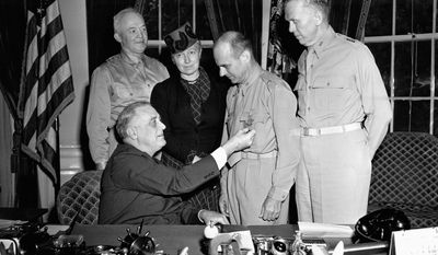 President Roosevelt pins the Medal of Honor on Doolittle at the White House on May 19, 1942, as his wife, Josephine Daniels Doolittle, watches. The flier also was promoted to brigadier general. (Associated Press)