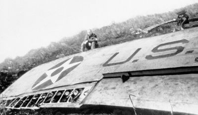 Doolittle sits above the U.S. Army Air Force insignia on his B-25 bomber, which crashed in China. Without enough fuel for a round trip, his men flew to China after the raid. (Associated Press)