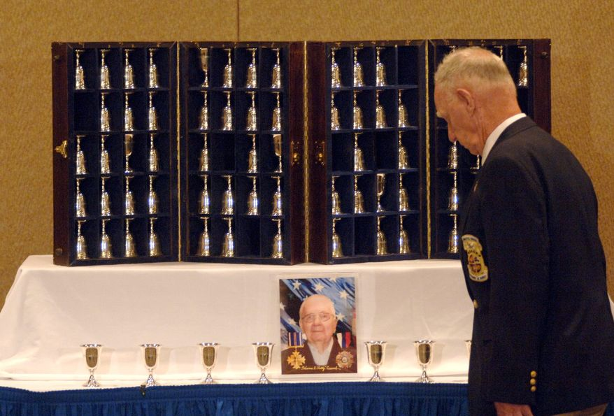 Retired Master Sgt. Ed Horton honors the memory of retired Lt. Col. Horrace Crouch by turning his goblet upside down in 2006. The tradition honors Raiders who have died since the last reunion. (U.S. Air Force)