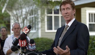 ** FILE ** Mark O'Mara, attorney for George Zimmerman, addresses reporters outside his offices in Orlando, Fla., April 11, 2012. (Associated Press)