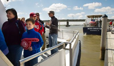 Kristi Poreda, left, of Alexandria, Va. and her son Nick, 9, arrive with other fans to the stadium by boat from Alexandria, Va. (Andrew Harnik/The Washington Times)