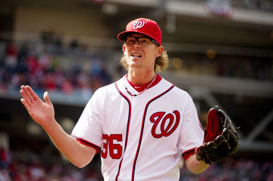 Washington Nationals relief pitcher Tyler Clippard (36) shows his emotion as he walks back to the dugout after the eighth inning. (Andrew Harnik/The Washington Times)