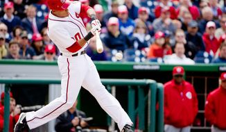 Washington Nationals shortstop Ian Desmond (20) bats as the Washington Nationals defeat the Cincinnati Reds in extra innings in their home opener. (Andrew Harnik/The Washington Times)