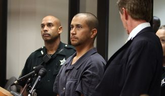 George Zimmerman (center) stands with his attorney Mark O'Mara (right) and a Seminole County Deputy during a court hearing April 12, 2012, in Sanford, Fla. Zimmerman has been charged with second-degree murder in the shooting death of 17-year-old Trayvon Martin. (Associated Press/Orlando Sentinel)