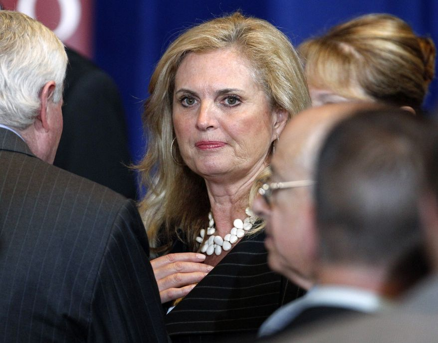 **FILE** Ann Romney, wife of Republican presidential candidate Gov. Mitt Romney, talks in Chicago on March 19, 2012, with audience members after her husband spoke at the University of Chicago. (Associated Press)