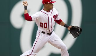 Washington Nationals shortstop Ian Desmond throws out a Cincinnati Reds runner during the ninth inning Thursday, April 12, 2012, in Washington. The Nationals won 3-2 in 10 innings. (AP Photo/Evan Vucci)