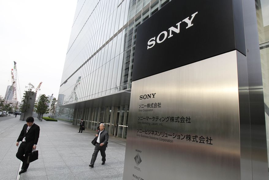 ** FILE ** Office workers leave the headquarters of Sony Corp. in Tokyo Tuesday, April 10, 2012. Faced with mounting losses, Sony Corp. said Thursday April 12, 2012, it will slash 10,000 jobs, or about 6 percent of its global workforce, and turn around its money-losing TV business over the next two years. (AP Photo/Koji Sasahara, File)