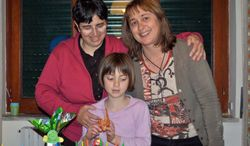 In this 2011 family photo, lesbian couple Giuseppina La Delfa (left) and Raphaelle Hoedts (right) celebrate the eighth birthday of their daughter, Lisa-Marie, in Naples, Italy. (Associated Press)