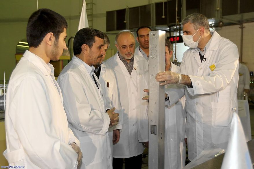 ** FILE ** In this Wednesday Feb. 15, 2012, file photo, released by the Iranian President's Office, claims to show Iranian President Mahmoud Ahmadinejad, second left being escorted by technicians during a tour of Tehran's research reactor center in northern Tehran, Iran. (AP Photo/Iranian President's Office, File)