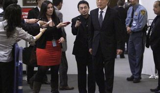 China's Ambassador Li Baodong, third from right, arrives for consultations at the United Nations on Friday, April 13, 2012. The United Nations Security Council is planning an emergency meeting to discuss Thursday's failed rocket launch by North Korea. (AP Photo/Bebeto Matthews)