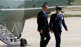 President Obama is escorted April 13, 2012, by Col. Kenneth R. Rizer, commander of the 11th Wing, upon his arrival at Andrews Air Force Base, Md., en route to Florida. (Associated Press)