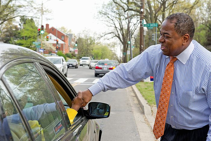 D.C. Council member Vincent B. Orange shakes hands with a supporter outside his campaign headquarters on South Dakota Avenue in Northeast D.C., on Friday, March 30, 2012. (Barbara L. Salisbury/The Washington Times)