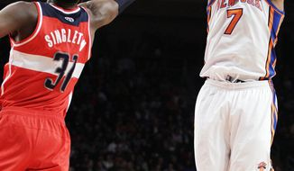 New York Knicks' Carmelo Anthony shoots over Washington Wizards' Chris Singleton during the first half Friday, April 13, 2012, in New York. Anthony had 18 points in the Knicks' rout. (AP Photo/Frank Franklin II)