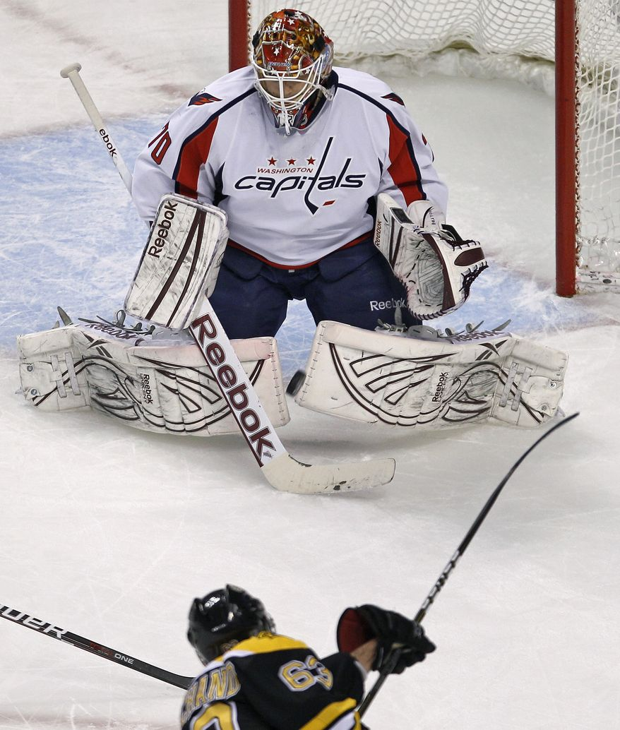 Washington Capitals goalie Braden Holtby drops to the ice to make a save on a shot by Boston Bruins left wing Brad Marchand during the first period of Game 2 of the Stanley Cup first-round playoff series in Boston on Saturday, April 13, 2012. AP Photo/Charles Krupa)
