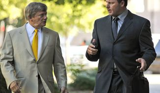 ** FILE ** In this July 13, 2011, file photo, former Major League Baseball pitcher Roger Clemens, right, and his attorney Rusty Hardin outside federal court in Washington. (AP Photo/Alex Brandon, File)