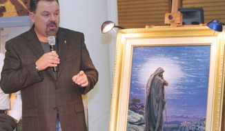 "** FILE ** Artist Thomas Kinkade unveils his painting ""Prayer for Peace"" at the opening of the exhibit ""From Abraham to Jesus"" in Atlanta in September 2006. Kinkade, 54, the self-described ""Painter of Light,"" died April 6, 2012, at his home in Los Gatos, Calif. (AP Photo/Gene Blythe)"