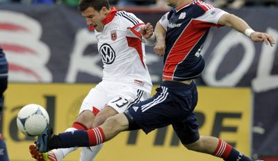 D.C. United's Chris Pontius (13) shoots the ball by the defense of New England Revolution's Stephen McCarthy, right, to score the winning goal during the second half of an MLS soccer match in Foxborough, Mass., Saturday, April 14, 2012. D.C. United won 2-1. (AP Photo/Elise Amendola)