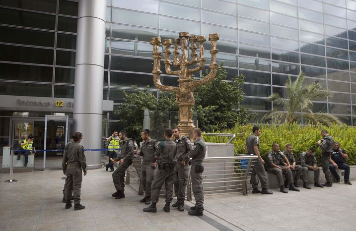 ** FILE ** Israeli police officers are deployed at the Ben Gurion Airport near Tel Aviv on Sunday, April 15, 2012, to detain activists flying in to protest the country's occupation of Palestinian