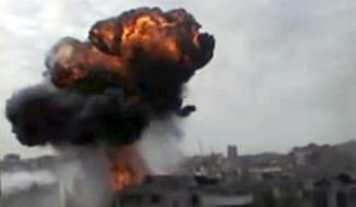 Smoke billows from the purported shelling of Homs, Syria, in an image from amateur video released by the Shaam News Network and accessed on Sunday, April 15, 2012. (AP Photo/Shaam News Network via AP video)