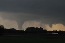 A tornado moves on the ground north of Solomon, Kan., on Saturday evening, April 14, 2012. Interstate 70 is in the foreground. (AP Photo/The Hutchinson News, Sandra J. Milburn)