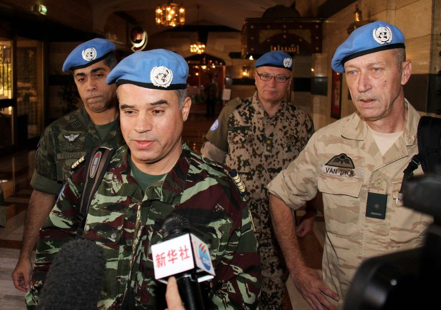 """We will start our mission as soon as possible and we hope it will be a success,"" says Col. Ahmed Himmiche (foreground) of Morocco before he and other U.N. observers leave a hotel in Damascus, Syria, on Monday. (Associated Press)"