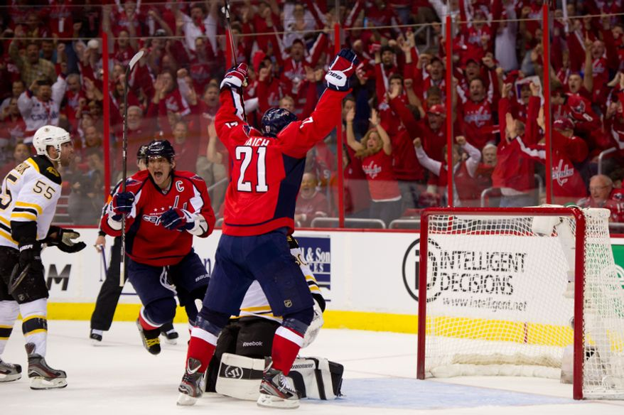 Washington Capitals left wing Alex Ovechkin (8), second from left, and Washington Capitals center Brooks Laich (21) third from left, celebrate the first goal of the game by Washington Capitals left wing Alexander Semin (28) in the first period as the Washington Capitals take on the Boston Bruins in game three of National Hockey League first round playoff hockey at the Verizon Center, Washington, D.C., Monday, April 16, 2012. (Andrew Harnik/The Washington Times)