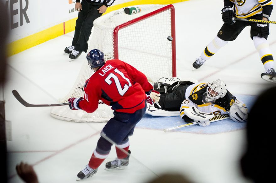 Washington Capitals center Brooks Laich (21) scores on Boston Bruins goalie Tim Thomas (30) to tie the game, 3-3, in the third period before the Washington Capitals lose to the Boston Bruins in game three, 3-4, of National Hockey League first round playoff hockey at the Verizon Center, Washington, D.C., Monday, April 16, 2012. (Andrew Harnik/The Washington Times)