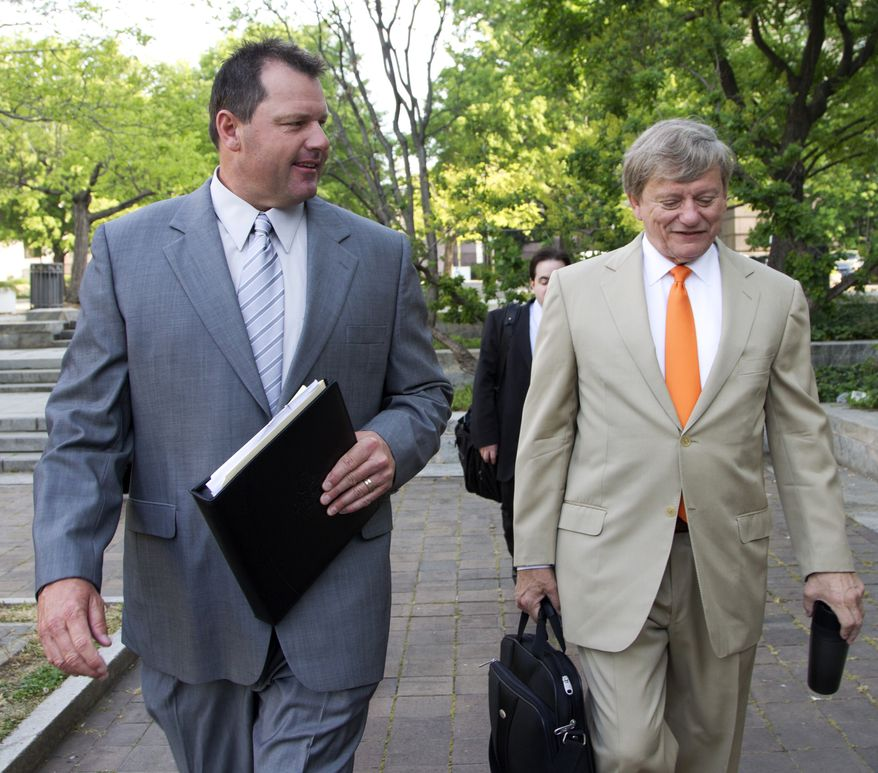 Former Major League Baseball pitcher Roger Clemens (left) and his attorney Rusty Hardin arrive at federal court in Washington on Monday, April 16, 2012, for jury selection in Clemens' perjury trial. (AP Photo/Manuel Balce Ceneta)
