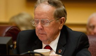 Sen. Charles J. Colgan, Prince William Democrat and a budget conferee, signed the conference report but has not said whether he will vote for the bill on the floor Tuesday. (Andrew Harnik/The Washington Times)